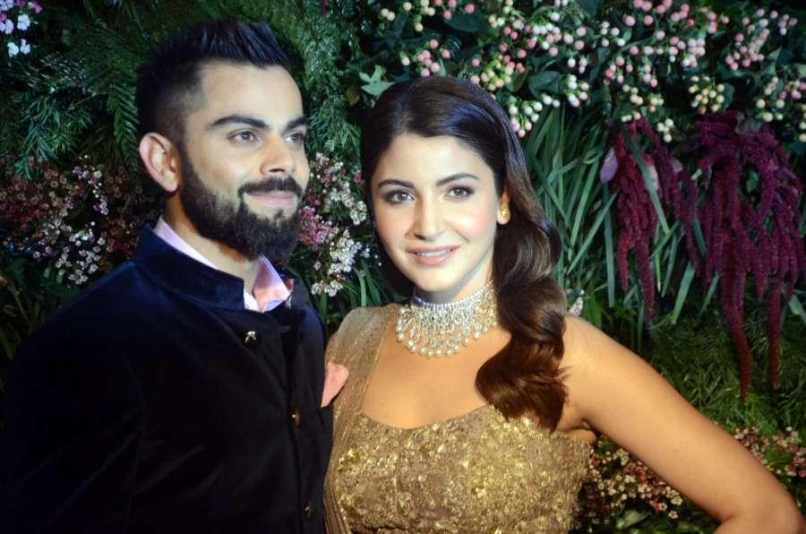 Mumbai: Indian cricket captain Virat Kohli and Anushka Sharma pose for a photograph during their wedding reception in Mumbai. (Photo: Sandeep Mahankal/IANS) by .