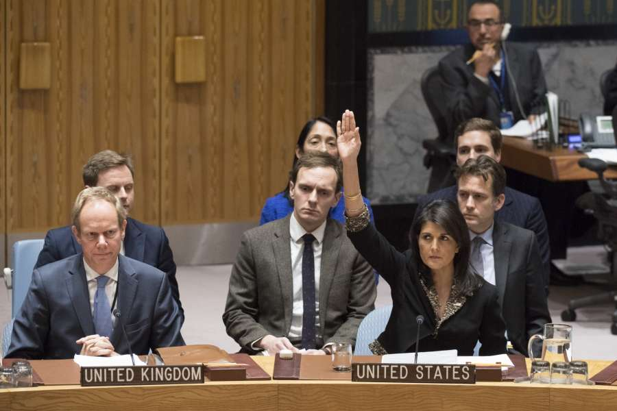 UNITED NATIONS, Dec. 18, 2017 (Xinhua) -- U.S. Ambassador to the United Nations Nikki Haley (R, front) vetoes a UN Security Council draft resolution on the status of Jerusalem at the UN headquarters in New York, on Dec. 18, 2017. The United States on Monday vetoed a Security Council draft resolution on the status of Jerusalem. All other 14 members of the Security Council voted in favor of the Egyptian-drafted text. But as the United States, which is a permanent member of the Security Council, has veto power, the draft resolution failed to be adopted. (Xinhua/UN Photo/IANS) by .
