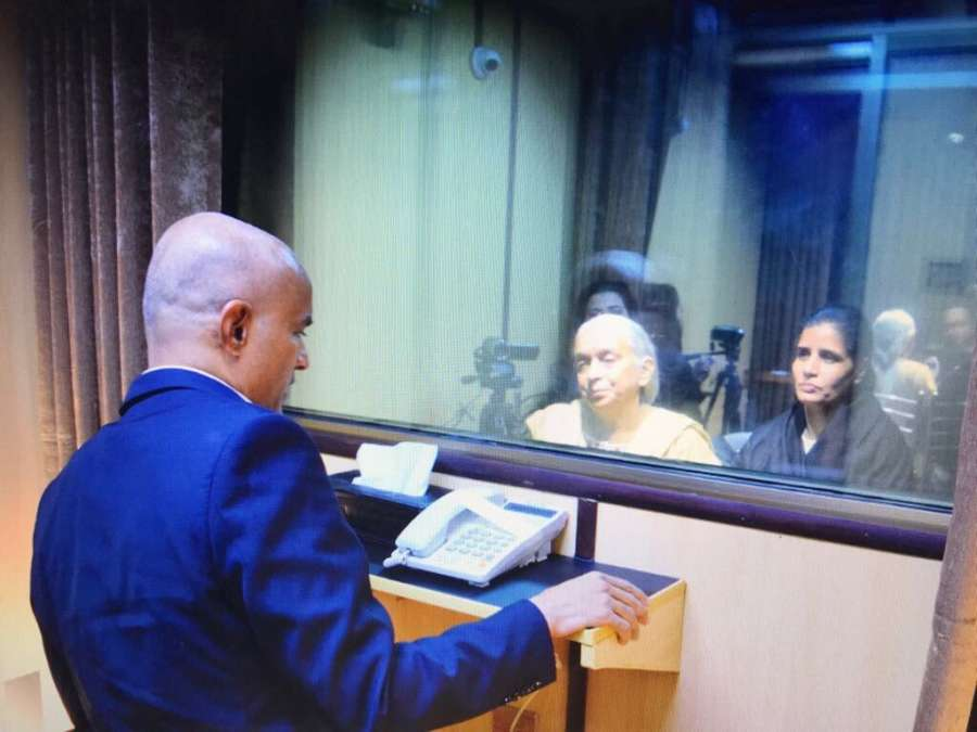Islamabad: The mother and wife of Mumbai-based former naval officer-turned-businessman Kulbhushan Jadhav, who was arrested on March 3, 2016, and was sentenced to death by a Pakistani military court on charges of espionage and terrorism meet him at the Pakistan Foreign Office in Islamabad on Dec 25, 2017. The meeting, with the death row prisoner lasted for about 40 minutes, but with a glass panel separating them and spoke through a speaker phone. The meeting started at 2.18 p.m., according to the Foreign Office. Indian Deputy High Commissioner J.P. Singh, who accompanied Jadhav's family, was seen watching the reunion from a distance. (Photo: Twitter/@ForeignOfficePk) by .