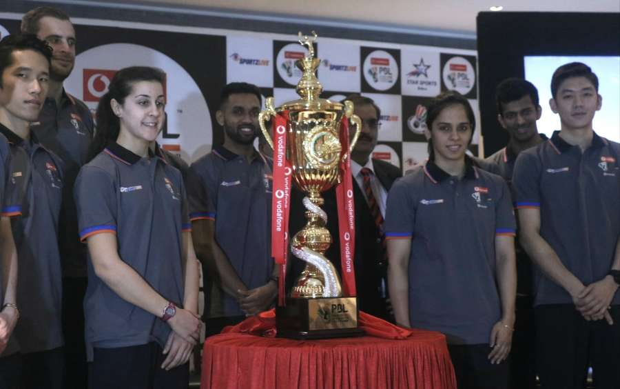 New Delhi: Badmonton players Saina Nehwal, Carolina Marin and other dignitaries during a programme organised to unveil Premier Badminton League (PBL) Trophy in New Delhi. (Photo: IANS) by .