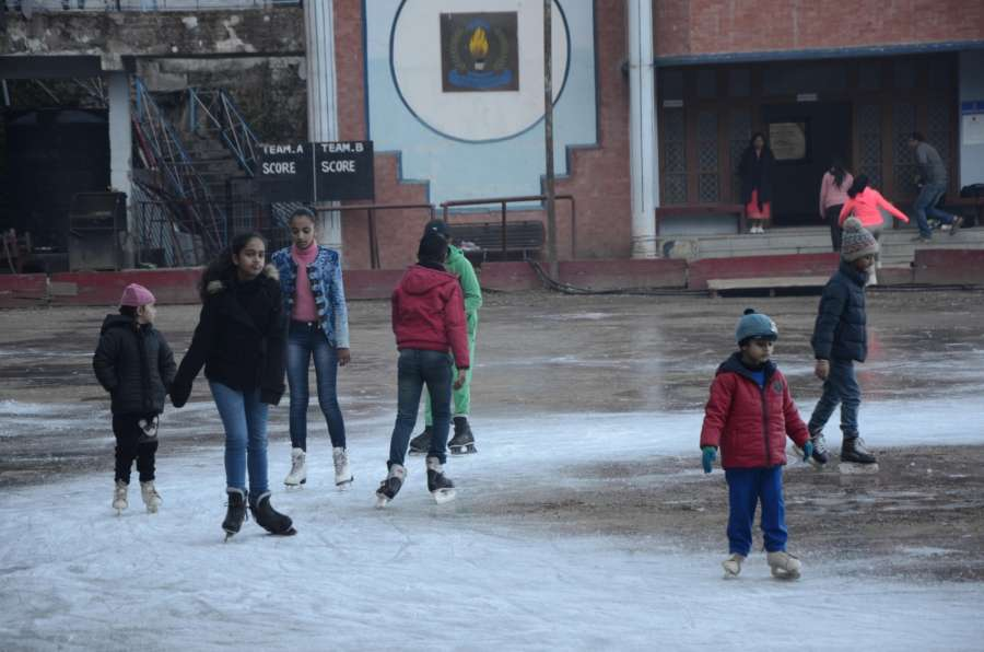 Shimla: Children enjoy ice skating in Shimla. (Photo: IANS) by .