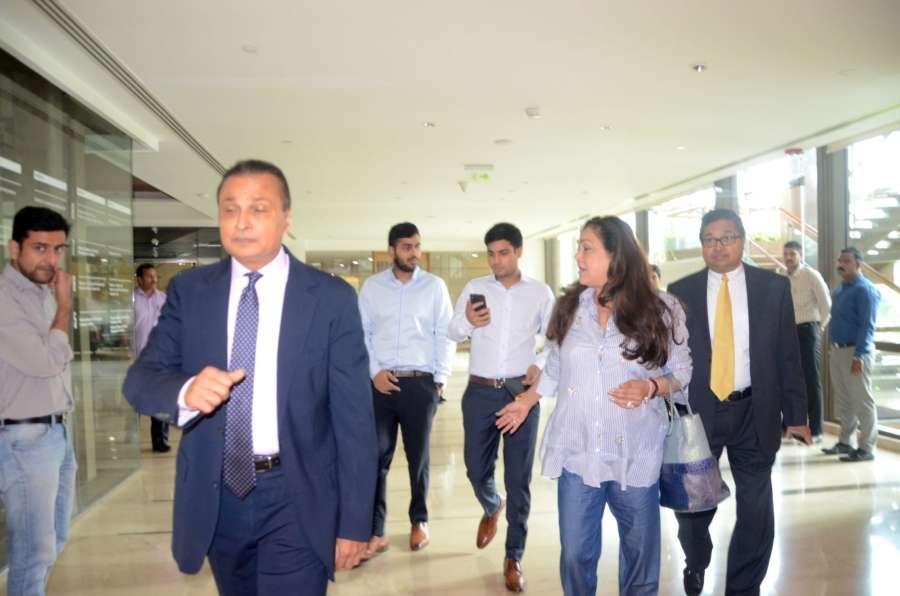 Mumbai: Reliance Group Chairman Anil Ambani, his wife Tina Ambani and their sons Anmol Ambani and Jai Anshul Ambani arrive to attend a press conference in Mumbai. (Photo: IANS) by .
