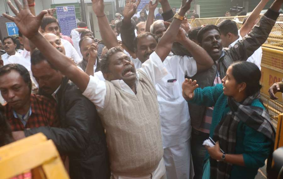 New Delhi: DMK workers celebrate as a Delhi court acquitted DMK leaders -- former Telecom Minister A.Raja and Rajya Sabha MP Kanimozhi in the alleged multi-thousand crore rupee 2G spectrum scandal, in New Delhi on Dec 21, 2017. (Photo: IANS) by .