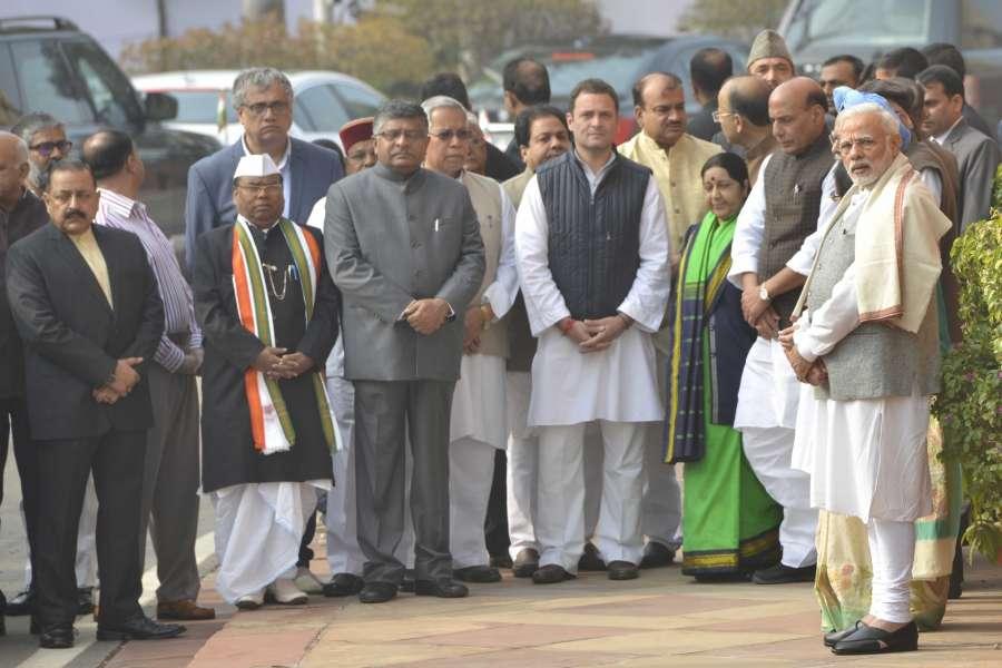 New Delhi: Prime Minister Narendra Modi with Union Ministers Rajnath Singh, Sushma Swaraj, Jitendra Singh, Ananth Kumar, Ravi Shankar Prasad andTrinamool Congress leader Derek O'Brien pay tributes to the martyrs of 2001 Parliament attack in New Delhi on Dec 13, 2017. (Photo: IANS) by .