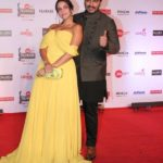 "Mumbai: Actors Neha Dhupia and Arjun Kapoor at the red carpet of ""63rd Jio Filmfare Awards"" in Mumbai on Jan 20, 2018.(Photo: IANS) by ."