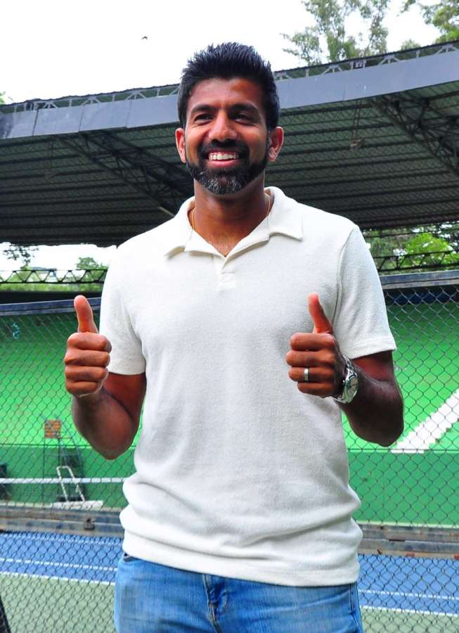Bengaluru: Indian Tennis player Rohan Bopanna celebrates his French Open mixed double victory at Karnataka State Lawn Tennis Association in Bengaluru, on June 10, 2017. (Photo: IANS) by .