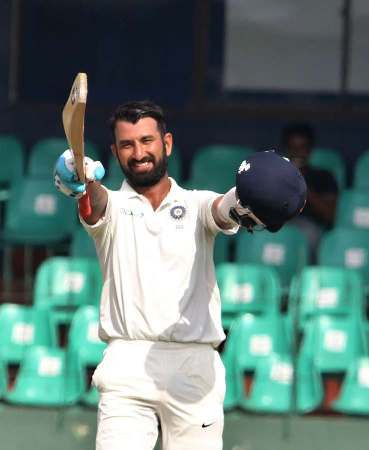 Colombo: India's Cheteshwar Pujara celebrates his century on Day 1 of the second test match between India and Sri Lanka at Sinhalese Sports Club Ground in Colombo, Sri Lanka. (Photo: Surjeet Yadav/IANS) by .