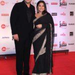 "Mumbai: Filmmaker Sidharth Roy Kapur along with his wife Vidya Balan at the red carpet of ""63rd Jio Filmfare Awards"" in Mumbai on Jan 20, 2018.(Photo: IANS) by ."