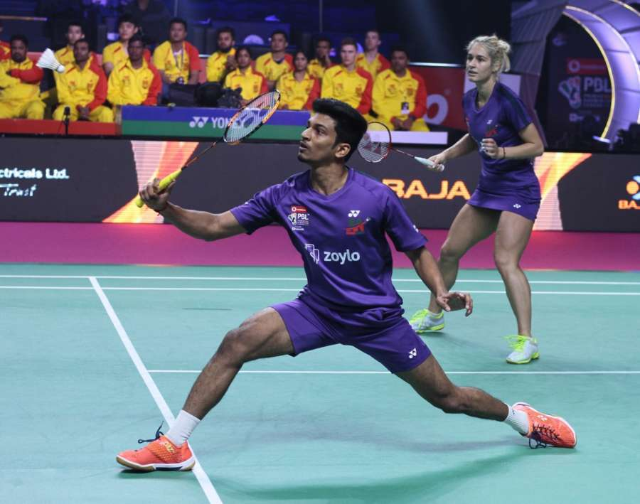 Lucknow: Gabriela Stoeva and M.R Arjun of Mumbai Rockets in action against Kim Sa Rang and Sikki Reddy of Bengaluru Blasters during a Premier Badminton League match in Lucknow. (Photo: IANS) by .