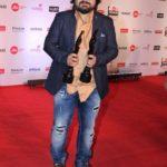 "Mumbai: Music composer Pritam Chakraborty at the red carpet of ""63rd Jio Filmfare Awards"" in Mumbai on Jan 20, 2018.(Photo: IANS) by ."