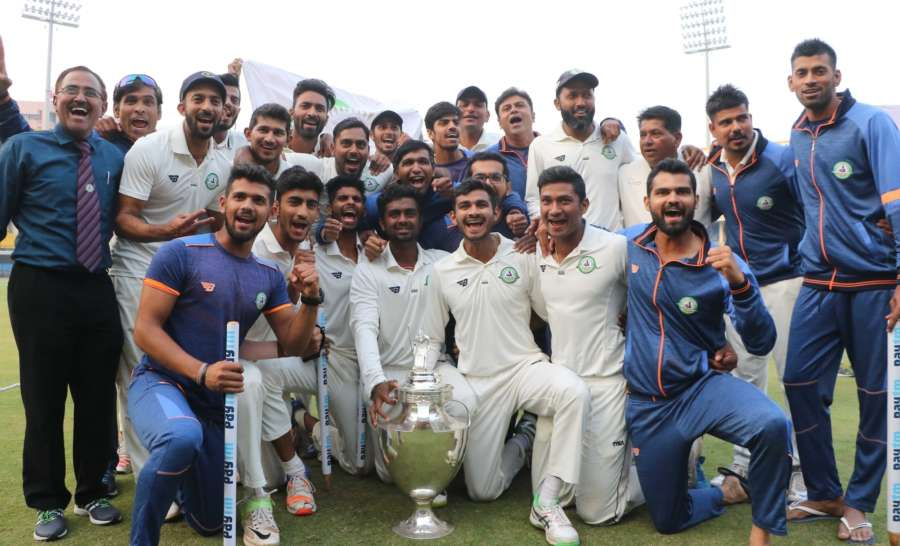 Indore: Vidarbha players celebrate after winning their maiden Ranji Trophy cricket title crushing Delhi by nine wickets on the fourth and penultimate day of their final at Holkar Stadium in Indore. (Photo: IANS) by .