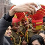 Attari: Actor Sidharth Malhotra take a selfie with BSF soldiers during his visit to celebrate Republic Day at Attari - Wagah international border on Jan. 26, 2018. (Photo: IANS) by .
