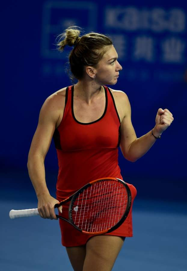 Simona Halep of Romania celebrates during the second round match against Duan Yingying of China at the WTA Shenzhen Open in Shenzhen, China. (Xinhua/Mao Siqian/IANS) by .