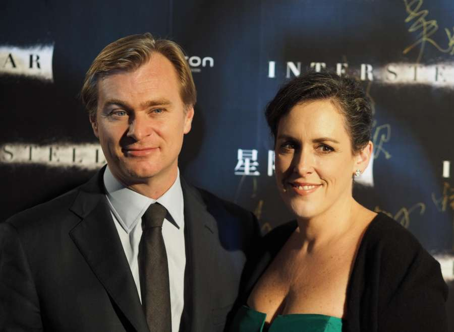 Shanghai (China): Director Christopher Nolan with his wife and producer Emma Thomas attend the Asia's premiere of the movie `Interstellar` in Shanghai Xintiandi. The film will be November 12 landed in mainland China. (Xinhua/Ren Longshe/IANS) by .