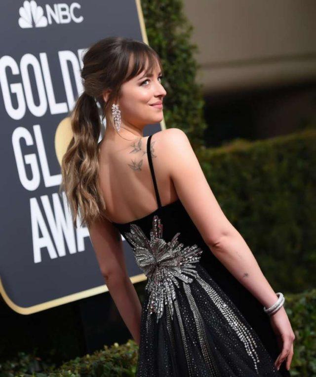 Los Angeles: Actress Dakota Johnson at 75th Golden Globe Awards in Los Angeles, California on Jan 7, 2018. (Photo: IANS) by .