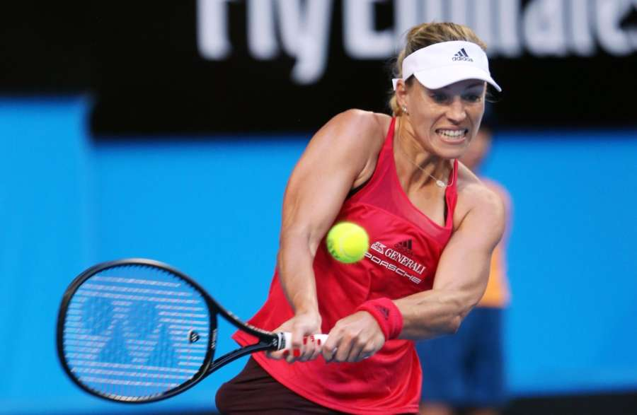 PERTH, (Xinhua) -- Angelique Kerber of Germany returns the ball to Elise Mertens of Belgium during a group match between Germany and Belgium at the Hopman Cup mixed teams tennis tournament in Perth, Australia. (Xinhua/Zhou Dan/IANS)by .