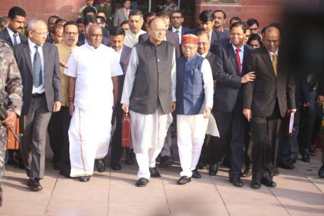 New Delhi: Arun Jaitley, Union Minister of Finance with Pratap Shukla, MOS (Finance), Pon. Radhakrishnan, MOS (Finance), Dr. Hasmukh Adhia, Finance Secretary and other officials at Finance Ministry before leaving for Parliament to present the Budget 2018-19 in Parliament on Feb. 1, 2018. (Photo: IANS) by .
