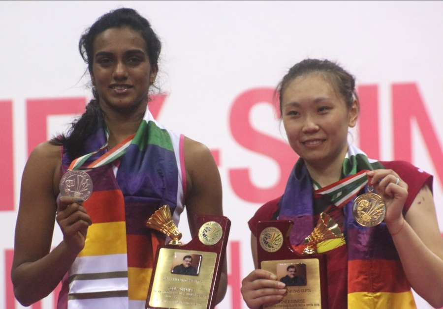 New Delhi: Indian shuttler PV Sindhu and American shuttler Beiwen Zhang with their trophies during Yonnex Sunrise Dr. Akhilesh Das Gupta India Open 2018 final at the Siri Fort Sports Complex in New Delhi on Feb 4, 2018. (Photo: IANS) by .