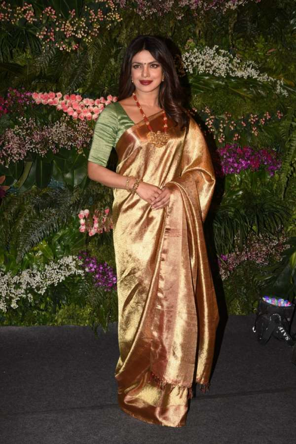 Mumbai: Actress Priyanka Chopra at the wedding reception of Indian cricket captain Virat Kohli and actress Anushka Sharma in Mumbai on Dec 26, 2017. (Photo: IANS) by .