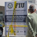 "MIAMI, March 15, 2018 (Xinhua) -- Photo taken on March 15, 2018 shows a signboard stating the construction project of the collapsed footbridge in Miami, Florida, the United States. A pedestrian footbridge near Florida International University (FIU) collapsed Thursday afternoon, causing ""several fatalities,"" local authorities said. (Xinhua/Monica McGivern/IANS) by ."