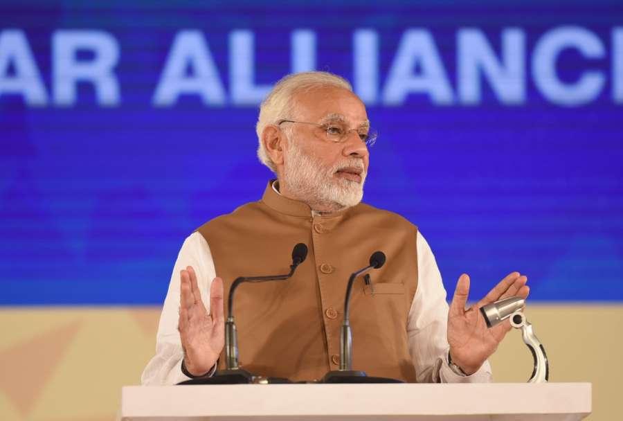 New Delhi: Prime Minister Narendra Modi addresses during the Founding Conference of International Solar Alliance (ISA) at Rashtrapati Bhavan in New Delhi on March 11, 2018. (Photo: IANS/PIB) by .