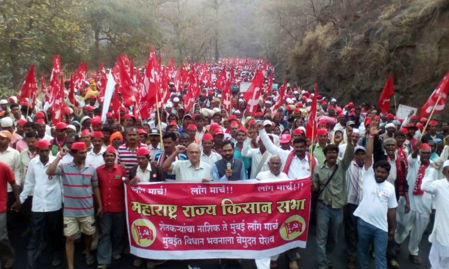 Bhiwandi: Farmers marching under the banner of Maharashtra Rajya Kisan Sabha reach Bhiwandi on March 10, 2018. 30,000 farmers had started marching against failure of the BJP-led government to address agrarian distress from Nashik on Tuesday and is expected to reach Mumbai on Sunday. (Photo: IANS) by .