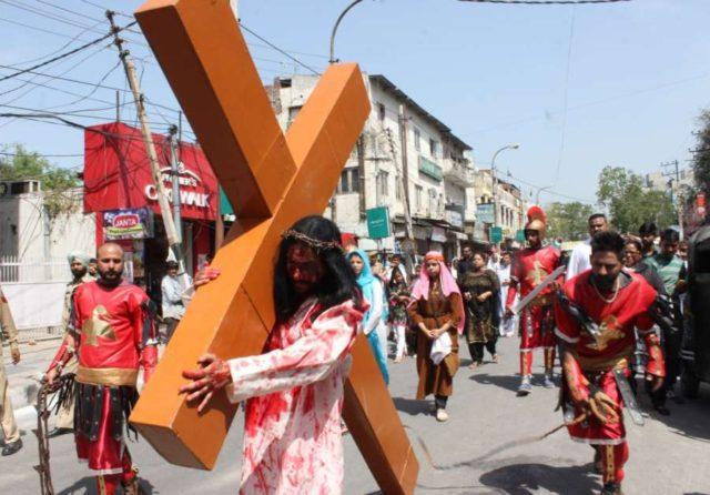Jammu: Devotees participate in a re-enactment of crucifixion of Jesus Christ on Good Friday in Jammu on April 14, 2017. (Photo: IANS) by .