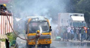Agra: A bus torched by protesters during a nation wide strike called to protest against the dilution of the SC/ST Prevention of Atrocities Act in Agra, on April 2, 2018. (Photo: IANS) by .