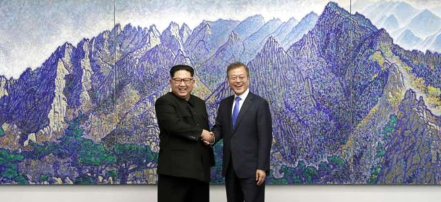 Panmunjom: South Korean President Moon Jae-in (R) shakes hands with North Korean leader Kim Jong-un ahead of a landmark summit at the Peace House in the truce village of Panmunjom on April 27, 2018. (Yonhap/IANS) by .