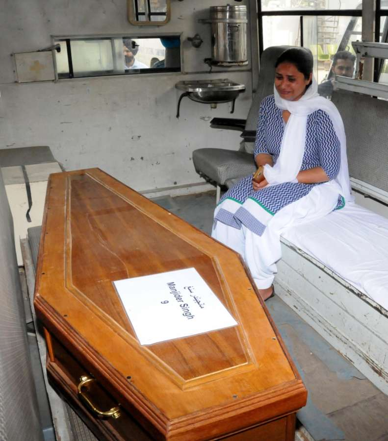 Amritsar: Coffin of one of the 39 Indian men killed by the Islamic State in Iraq's Mosul in 2014 arrives in Amritsar on April 2, 2018. Although 39 Indians were killed as the Islamic State took over Mosul, the mortal remains of 38 were brought back as the identification of one body is still pending. (Photo: IANS) by .