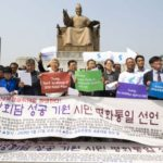 Panmunjom: South Korean activists hold a news conference at Gwanghwamun Square in central Seoul on April 27, 2018, to wish for the success of a landmark inter-Korean summit at the truce village of Panmunjom.(Yonhap/IANS) by .