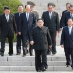 Panmunjom: North Korean leader Kim Jong-un and his entourage walk down from Panmungak Pavilion in the North to cross the inter-Korean border for talks with his South Korean counterpart Moon Jae-in at the truce village of Panmunjom on April 27, 2018.(Yonhap/IANS) by .