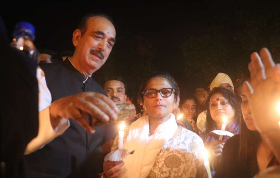 New Delhi: Congress leaders Ghulam Nabi Azad and Sushmita Dev participate in a candlelight vigil called by party president Rahul Gandhi to protest against incidents of rape in Unnao (Uttar Pradesh) and Kathua (Jammu and Kashmir) at India Gate in New Delhi on April 12, 2018. (Photo: Bidesh Manna/IANS) by .