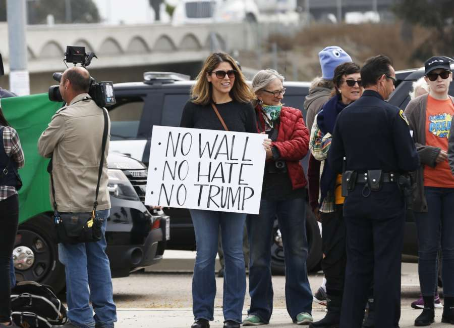 SAN DIEGO (U.S.), March 13, 2018 (Xinhua) -- A woman protests near the border wall prototypes in San Diego, the United States, on March 13, 2018. U.S. President Donald Trump on Tuesday inspected prototypes for his long-promised wall along the border with Mexico in a tour that drew both supporters and protesters. (Xinhua/Li Ying/IANS) by .