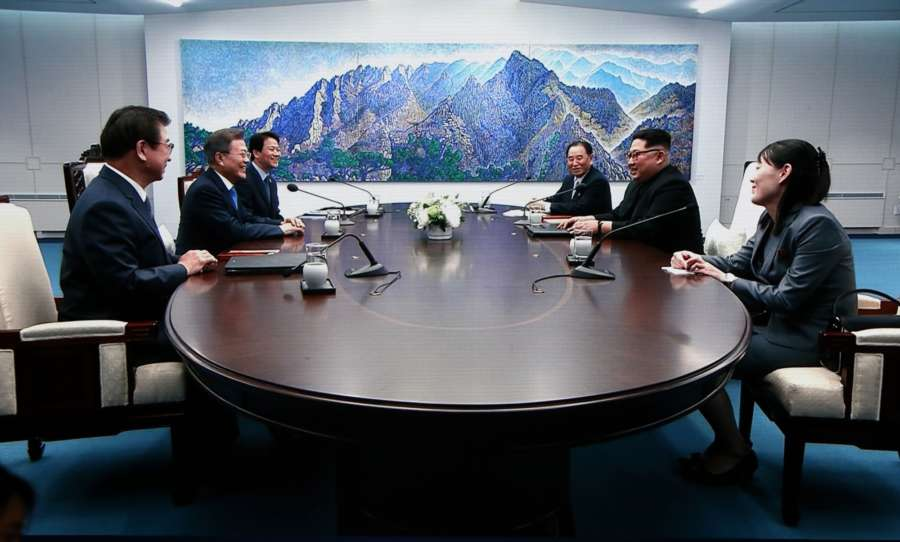 PANMUNJOM, April 27, 2018 (Xinhua) -- Photo taken on April 27, 2018 from TV screen shows South Korean President Moon Jae-in (2nd L) meeting with top leader of the Democratic People's Republic of Korea (DPRK) Kim Jong Un (2nd R) at the Peace House, a building in the South Korean side of Panmunjom. Moon Jae-in arrived Friday morning in the border village of Panmunjom for his first summit with Kim Jong Un. (Xinhua/Li Peng/IANS) by .