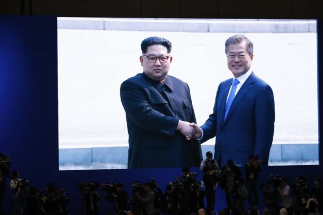 GOYANG (South Korea), April 27, 2018 (Xinhua) -- Photo taken on April 27, 2018 at the media center in Goyang, South Korea, shows a screen broadcasting South Korean President Moon Jae-in (R) shaking hands with top leader of the Democratic People's Republic of Korea (DPRK) Kim Jong Un in the border village of Panmunjom. Moon Jae-in arrived Friday morning in the border village of Panmunjom for his first summit with Kim Jong Un. (Xinhua/Wang Jingqiang/IANS) by .