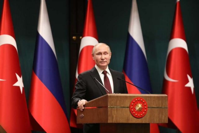 ANKARA, April 3, 2018 (Xinhua) -- Russian President Vladimir Putin attends a joint press conference with Turkish President Recep Tayyip Erdogan (not in the picture) following their meeting in Ankara, Turkey, April 3, 2018. Vladimir Putin said Tuesday that Russia and Turkey agreed to bring forward the delivery of the S-400 missile defense systems to Turkey. (Xinhua/Mustafa Kaya/IANS) by .