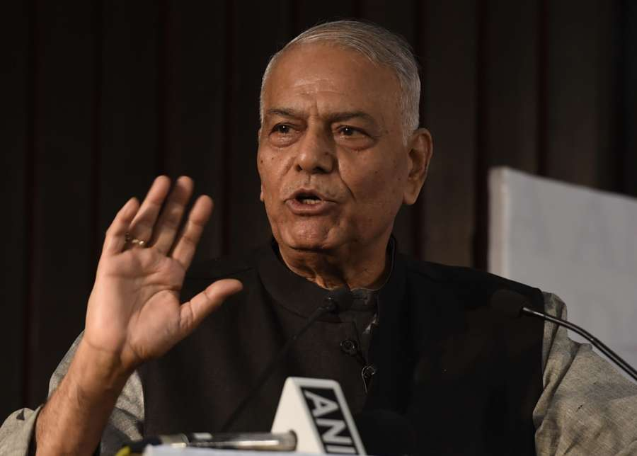 "New Delhi: BJP leader Yashwant Sinha addresses at the release of Congress leader Manish Tewari's book ""Tidings of Troubled Times"" in New Delhi, on Oct 5, 2017. (Photo: IANS) by ."