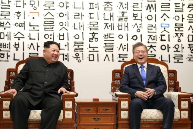 Panmunjom: South Korean President Moon Jae-in (R) and North Korean leader Kim Jong-un burst into laughter as they talk ahead of a landmark summit at the Peace House in the truce village of Panmunjom on April 27, 2018.(Yonhap/IANS) by .