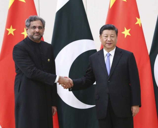 BOAO, April 10, 2018 (Xinhua) -- Chinese President Xi Jinping (R) meets with Pakistani Prime Minister Shahid Khaqan Abbasi in Boao, south China's Hainan Province, April 10, 2018. (Xinhua/Xie Huanchi/IANS) by .