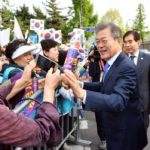 Panmunjom: South Korean President Moon Jae-in meets with well-wishers near his office in Seoul on April 27, 2018, as he heads to the truce village of Panmunjom for a historic summit with North Korean leader Kim Jong-un. (Yonhap/IANS) by .