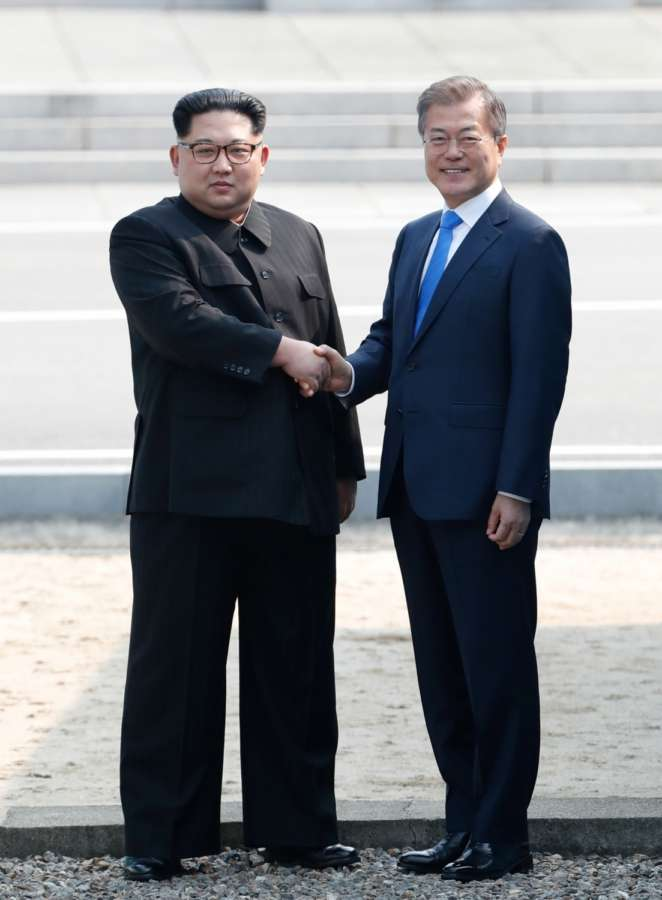 PANMUNJOM, April 27, 2018 (Xinhua) -- South Korean President Moon Jae-in (R) shakes hands with top leader of the Democratic People's Republic of Korea (DPRK) Kim Jong Un in the border village of Panmunjom on April 27, 2018. Moon Jae-in arrived Friday morning in the border village of Panmunjom for his first summit with Kim Jong Un. (Xinhua/Inter-Korean Summit Press Corps/IANS) by .