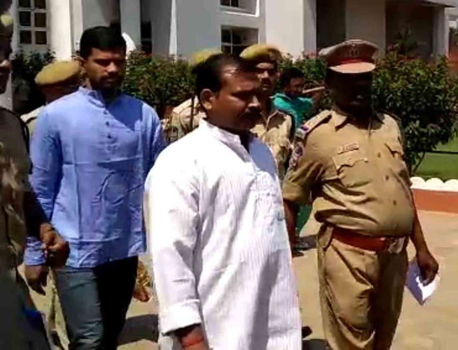 Hyderabad: Swami Aseemanand and other accused in the 2007 Makkah Masjid bomb blast case, walks out of court premises in Hyderabad on April 16, 2018. A special National Investigation Agency (NIA) court acquitted all five accused in the 2007 Makkah Masjid bomb blast case. (Photo: IANS) by .