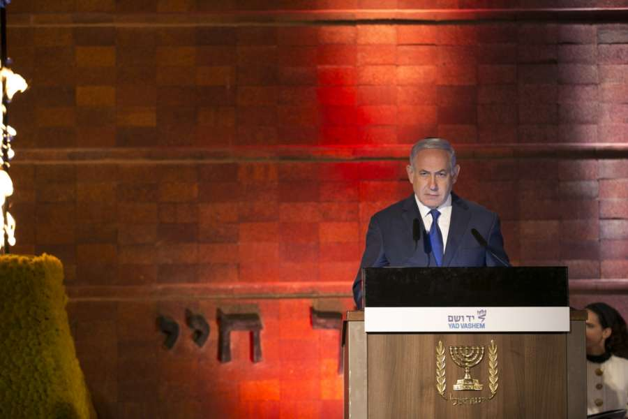 JERUSALEM, April 11, 2018 (Xinhua) -- Israeli Prime Minister Benjamin Netanyahu speaks at an official ceremony marking the Holocaust Remembrance Day at Yad Vashem World Holocaust Remembrance Center in Jerusalem, on April 11, 2018. Israel marked its annual day of Holocaust remembrance on Wednesday evening with an official ceremony held in Jerusalem. (Xinhua/Du Zhen/IANS) by .