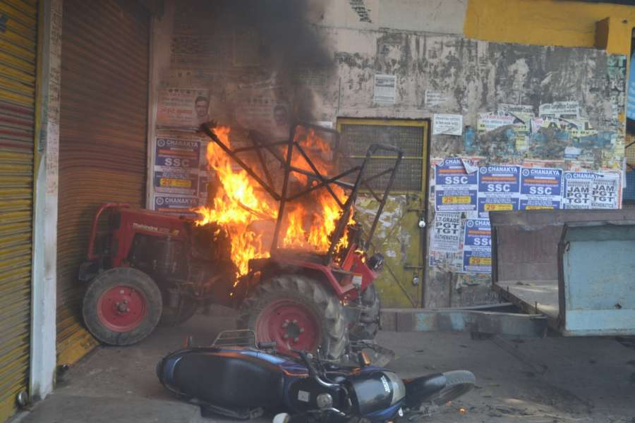 Meerut: A tractor set ablaze by protesters during a nation wide strike called to protest against the dilution of the SC/ST Prevention of Atrocities Act in Meerut, on April 2, 2018. (Photo: IANS) by .