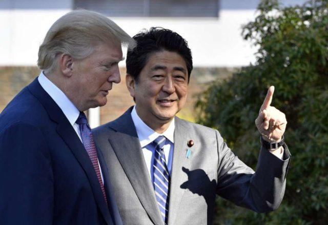 TOKYO, Nov. 5, 2017 (Xinhua) -- U.S. President Donald Trump (L) is greeted by Japanese Prime Minister Shinzo Abe upon his arrival at the Kasumigaseki Country Club in Kawagoe, near Tokyo, Japan, Nov. 5, 2017. (Xinhua/IANS) by .