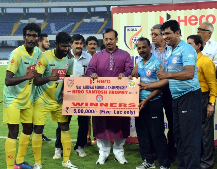 Kolkata: Players of Kerala during the post match presentation ceremony after winning Santosh Trophy match against Bengal at the Vivekananda Yuvabharati Krirangan in Kolkata on April 1, 2018. Kerala beat defending champions Bengal 4-2 in the tie-breaker after the final ended 2-2 in extra time to win the 72nd edition of the Santosh Trophy football tournament. (Photo: IANS) by .
