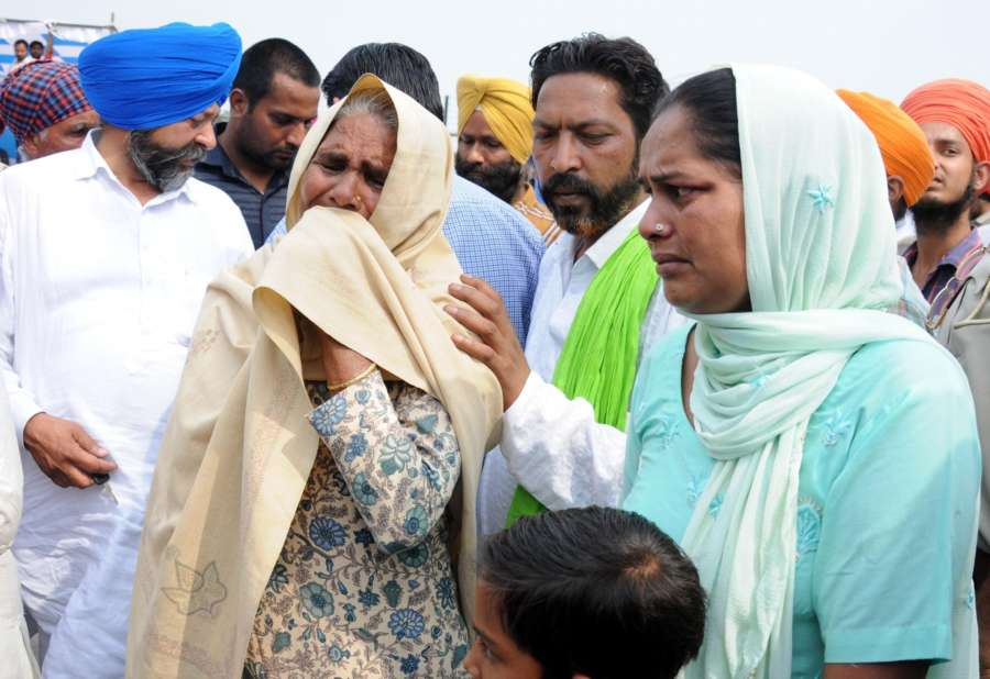 Amritsar: Grief struck family members of the Indian men killed by the Islamic State in Iraq's Mosul after coffins of the 38 Indian men killed by the Islamic State in Iraq's Mosul in 2014 were brought to India; in Amritsar on April 2, 2018. Although 39 Indians were killed as the Islamic State took over Mosul, the mortal remains of 38 were brought back as the identification of one body is still pending. (Photo: IANS) by .