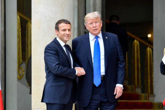 PARIS, July 13, 2017 (Xinhua) -- French President Emmanuel Macron (L) shakes hands with U.S. President Donald Trump at the Elysees Palace in Paris, France, on July 13, 2017. U.S. President Donald Trump arrived in Paris on Thursday morning in a diplomatic move to soften divergence with France over climate change and trade liberalization by seeking common ground on security and fight against terrorism. (Xinhua/Chen Yichen/IANS) by .