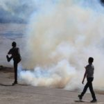 HEBRON, March 31, 2018 (Xinhua) -- A Palestinian protester tries to throw back a tear gas canister fired by Israeli soldiers during a clash in the West Bank city of Hebron, on March 31, 2018. The clash broke out after Friday that left some 15 Palestinians killed and more than 1,400 wounded by the Israeli Defense Forces gunfire in the clashes along the Israel-Gaza border. (Xinhua/Mamoun Wazwaz/IANS) by .